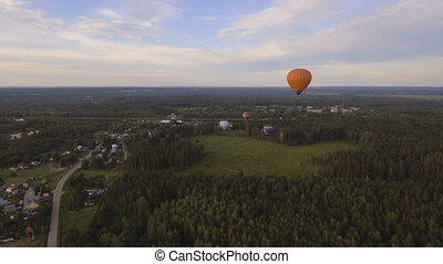 Hot air balloon in the sky over a field.Aerial view - Hot...