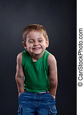 laughing kid - picture of a laughing young kid over dark...