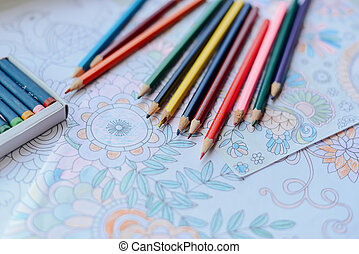 Image of woman coloring, adult coloring book trend, for...