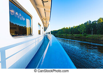 boat trip on the river - view of the side of a river cruise...
