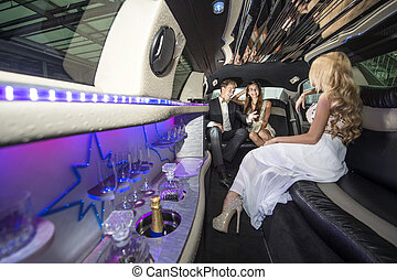 Celebrities in a luxurious limousine