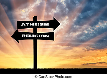 Road sign atheism and religion at sunset - Belief concept...