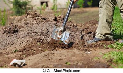 Man diging ground in garden