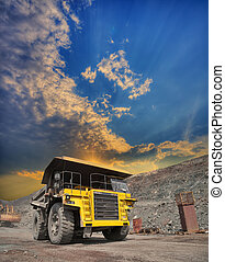 Mining truck on the opencast - Mining truck loaded with iron...