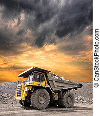 Heavy Mining Truck - Heavy mining truck driving through the...