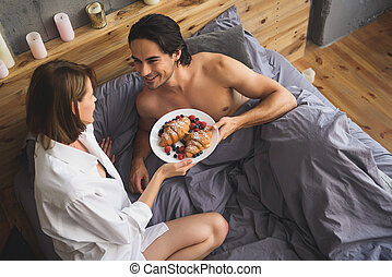 couple holding plate with dessert - couple holding plate...