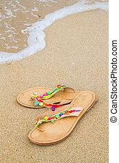 Summer flip flops on the beach