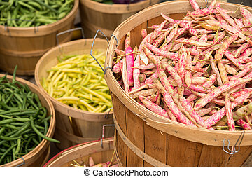 Different types of beans at the market : cranberry beans,...