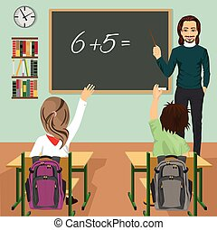 male teacher writing mathematic task on green chalkboard in classroom and children raising hands up