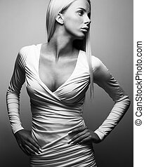 Black and white fashion portrait of blonde woman in dress -...