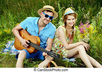 enamored couple - Enamored young man with a guitar singing...