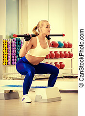 weight lifting - Beautiful athletic woman doing exercises...