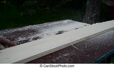 Worker sawing board of circular saw - Worker sawing board of...