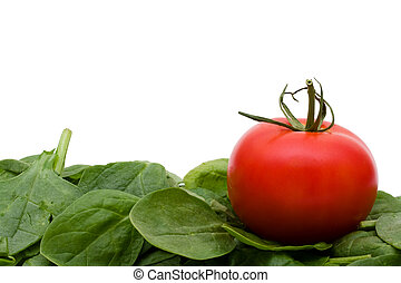 Super Food Spinach - A pile of spinach with a tomato...