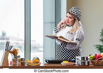 Young chef cook working in the kitchen