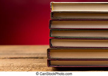 stack of books - Books on wooden table close up photo
