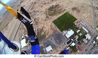 Skydiver parachuting in sky. Extreme sport. Adrenaline....