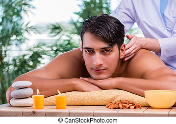 Man during massage session in spa salon