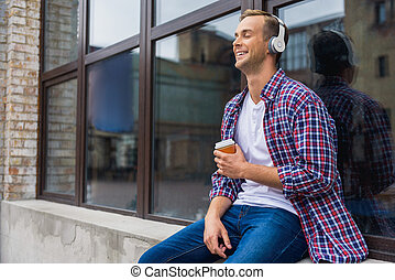 Handsome man standing outside of office building - Absorbed...