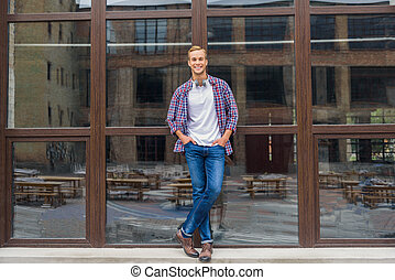 Handsome man standing outside of office building - Cool and...