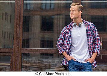 Handsome man standing outside of office building - Ready to...