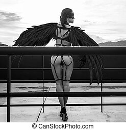 Black angel woman on the roof