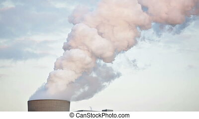 Steaming Cooling Tower In The Evening - Cooling tower of a...