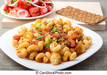 Cooked pasta cavatappi with stewed vegetables sauce and...