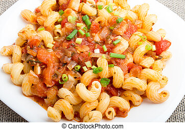 Close Up view on cavatappi pasta with a sauce of stewed...
