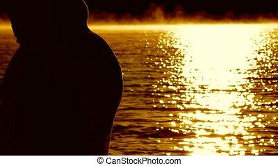 Pregnant Silhouette Admiring The Dawn Sun.