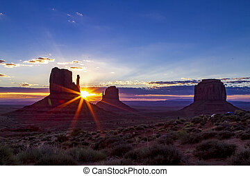Monument Valley Navajo Tribal Park - Colorful sunrise over...