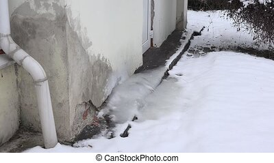 Residential air conditioner unit on frozen with ice on house...