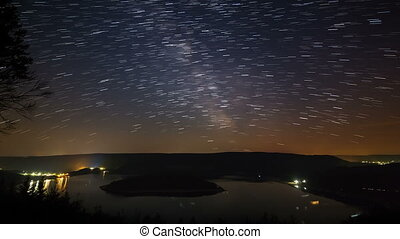 Star Trails Above Lake Timelapse - Timelapse sequence of the...