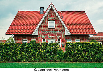 Two-storey House in Small City - Two-storey House behind the...