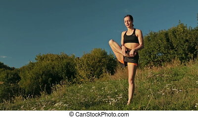 Sporty woman doing Ashtanga yoga in the park at sunset -...