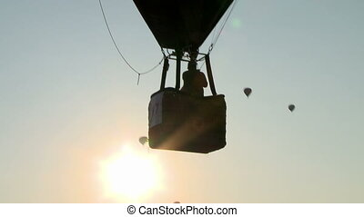 View of cabin hot air balloon on sky background