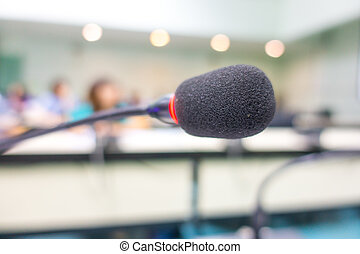 Black microphone in conference room ( Filtered image...