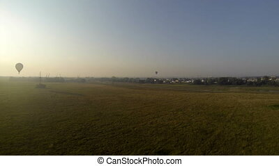 Early morning flight in hot air balloon. Top view