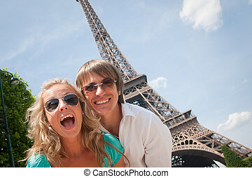 Happy couple in Paris - Happy young couple having fun in...