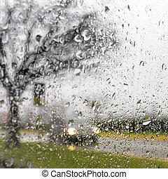 Driving in the rain - Blurry car silhouette seen through...