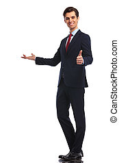 young business man presenting and making the ok sign - full...
