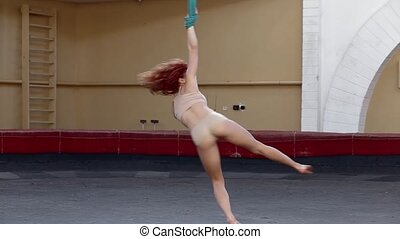 Aerial gymnast prepares for the circus number