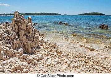 Rocky beach in Istria, Croatia - Rocky beach, bue sea and...