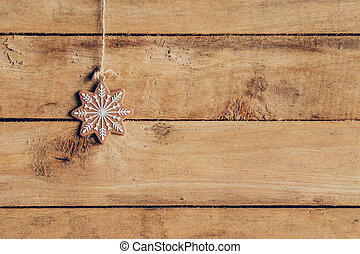 Christmas decoration hanging on wood background texture with...