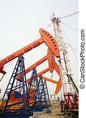 Drilling rig and  pumpjacks