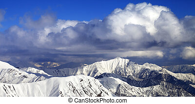 Panoramic view on snowy ridges in sun winter day Caucasus...