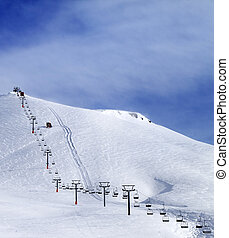 Ski slope and chair-lift at morning. Caucasus Mountains....