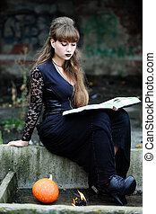witch with a book of spells