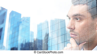 close up of male face over office buildings - business,...
