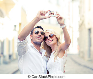 travelling couple taking photo picture with camera - summer...
